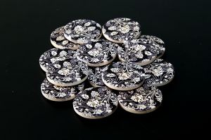 Wooden buttons with black and white pattern