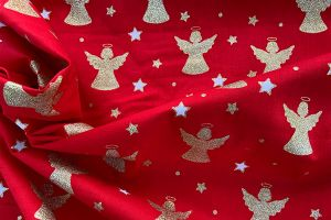 Gold angel on red 100% cotton print