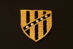 Gold and black shield style iron-on motif