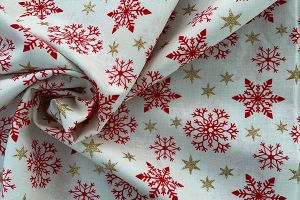 Red and gold star on cream 100% cotton print