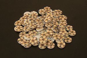 Round mother of pearl button with flower pattern
