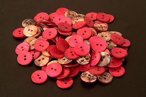 Round red mother of pearl buttons