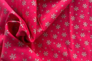 Gold snowflakes on red 100% cotton